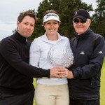 Rebecca Artis of Australia with her trophy and coaches Gary and Luke Edwin